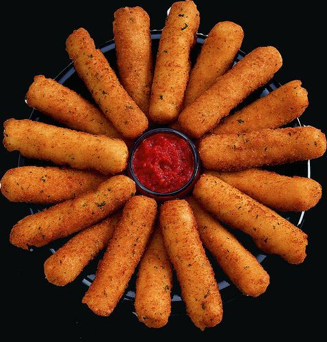 Mozzarella Sticks   So easy to make! Just cut mozzarella cheese sticks/ string cheese in half, dip in beaten eggs, and roll around in Italian bread crumbs dip the cheese stick in the eggs and crumbs again, then put in a pan of hot olive oil and turn until golden. SO easy and absolutely amazing!