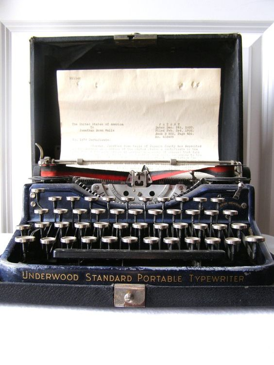 Vintage underwood portable typewriter..have one very similar to this one.  lucky me.