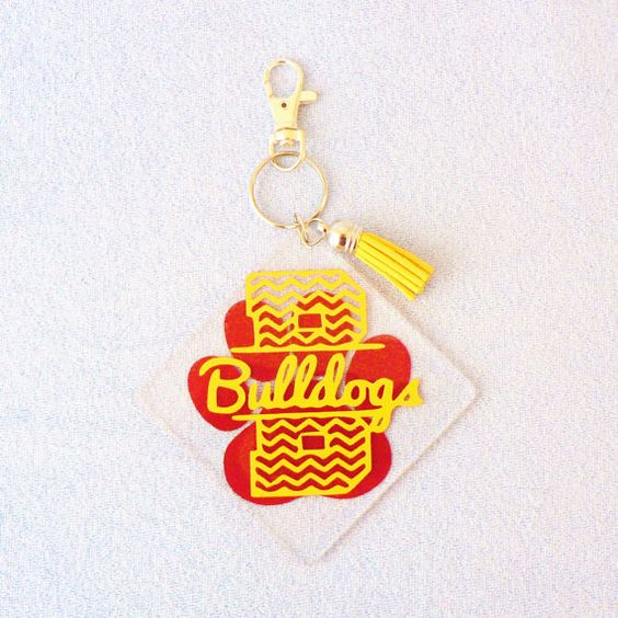 Check out this item in my Etsy shop https://www.etsy.com/listing/268848433/bulldog-keychain-paw-print-keychain