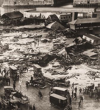 The Boston Molasses Disaster, also known as the Great Molasses Flood and the Great Boston Molasses Tragedy, occurred on January 15, 1919, in the North End neighborhood of Boston, Massachusetts in the United States. A large molasses storage tank burst, and a wave of molasses rushed through the streets at an estimated 35 mph (56 km/h), killing 21 and injuring 150. The event has entered local folklore, and residents claim that on hot summer days, the area still smells of molasses.