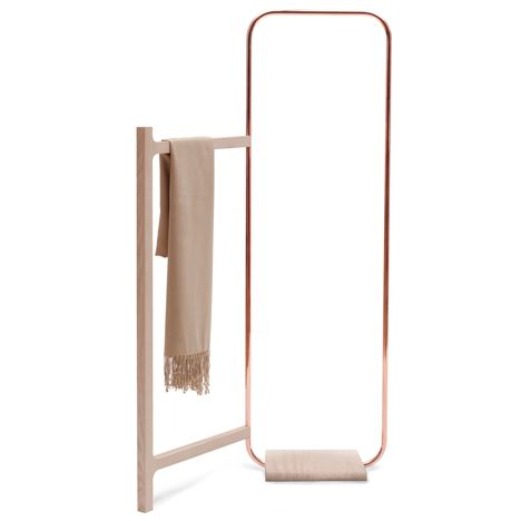 This clothes rack features a copper arc with a hinged timber frame allowing it to slot into the - Coat rack for small spaces design ...