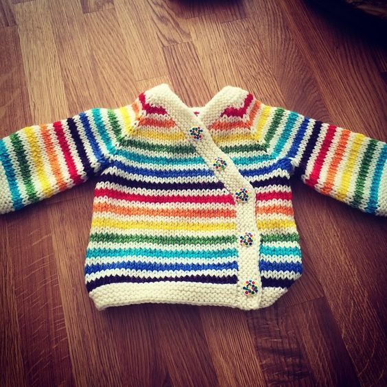 Carina Spencer gift wrap sweater in rainbow stripes and cream, buttons from hobbycraft
