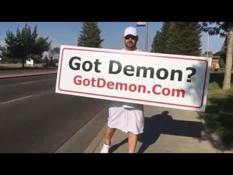 "Brother Carlos waving his ""Got Demon?"" Mobile Billboard in Fresno, Calif..."