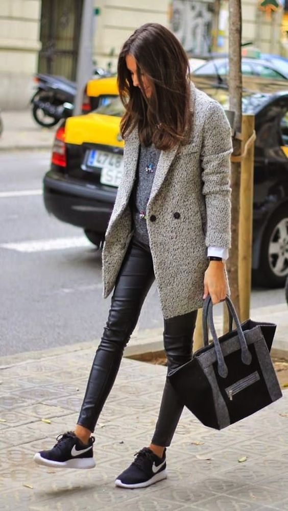 Incorporating trainers into an otherwise sleek outfit for an edge.