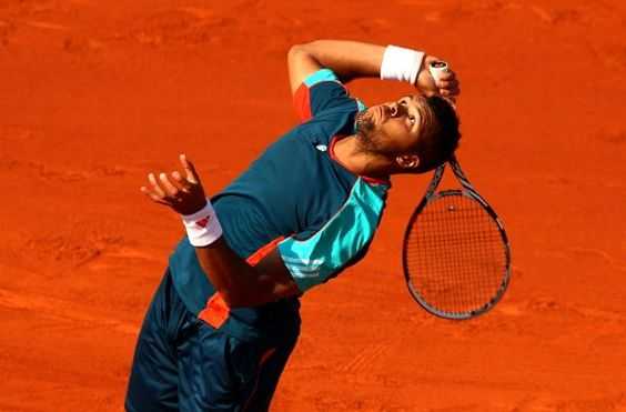 PARIS, FRANCE - MAY 27: Jo-Wilfried Tsonga of France serves during the men's singles first round match between Andrey Kuznetsov of Russia and Jo-Wilfried Tsonga of France on day one of the French Open at Roland Garros on May 27, 2012 in Paris, France. (Photo by Clive Brunskill/Getty Images)