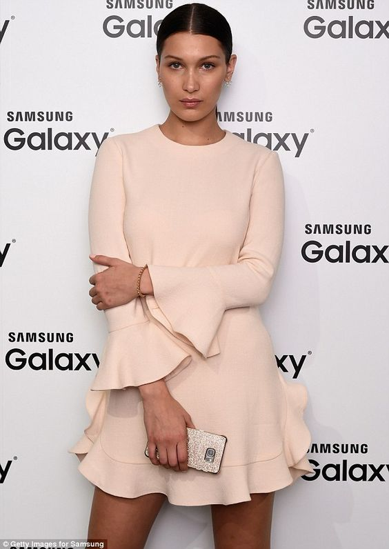 Business professional: The younger sister of Gigi Hadid cloaked her figure in a long sleeve frock that featured billowy detailing on the cuffs and bottom hemline