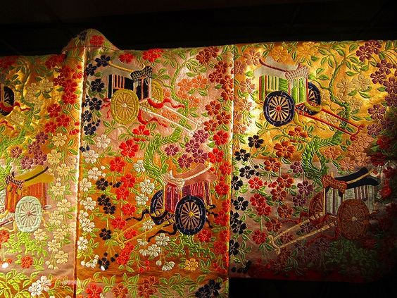 KARAORI   Noh costumes are usually worn as the outer garment for the roles of women. The woven textiles from which they are made, also called karaori, are characterized by long brocading wefts that resemble embroidery.