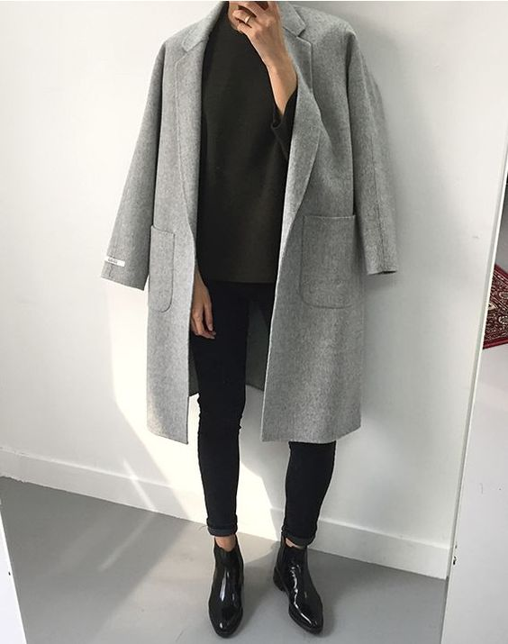Super chic but simple ootd. Patent Chelsea boots cleverly paired with skinny black jeans that cut off above the ankle. Effortless vibes with a black blouse and matched with a broad, boxy shouldered wool grey jacket. The deep pockets are also convenient.: