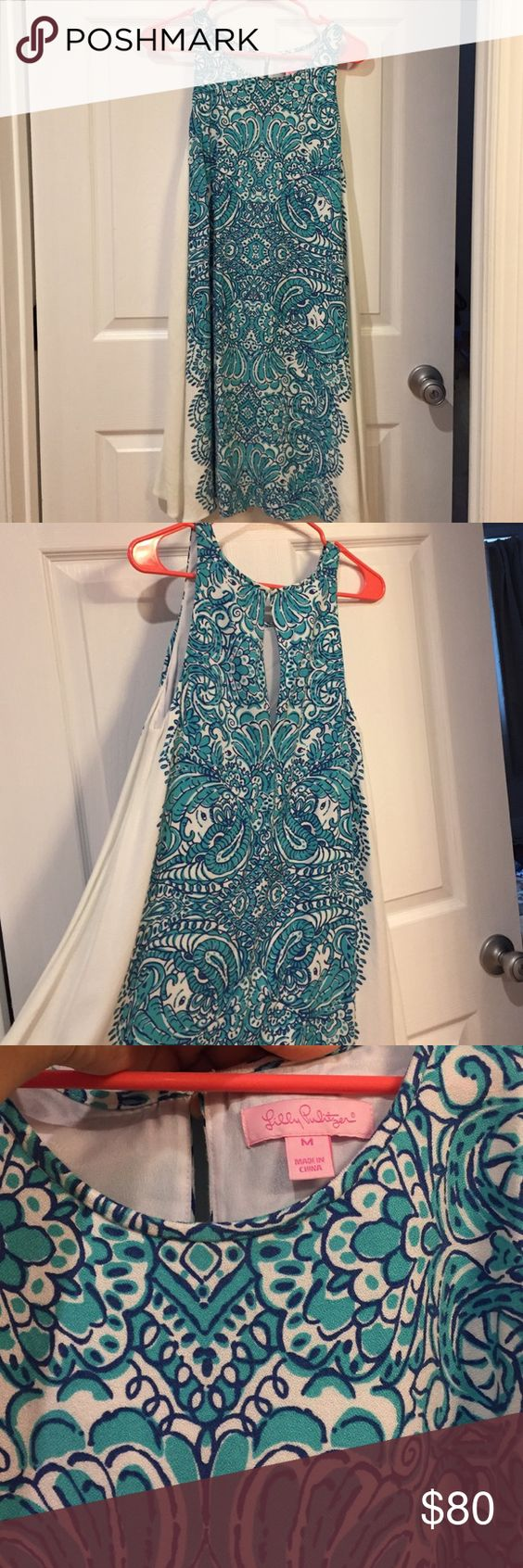 Size Medium Lilly Pulitzer dress Size medium dress from Lilly Pulitzer. I cannot think of the name of this print lol. I wore it once but completely forgot I owned it. Very comfortable! Accepting offers! Lilly Pulitzer Dresses Midi