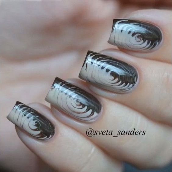 Cute And Creative Swirl Nail Art. Created using a technique called water marbling. It involves swirling together different colored nail polishes on nails. http://hative.com/cute-and-creative-swirl-nail-art/