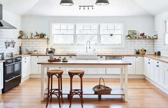 white cabinets with warm wood counter tops