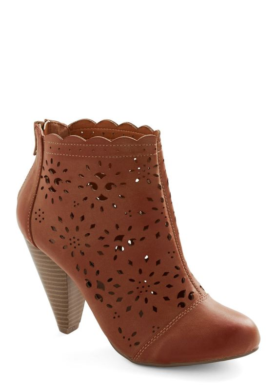 Burst of Beauty Bootie. Give a simple look some fashionable flair by back-zipping these brown booties on as a finishing touch. #brown #modcloth