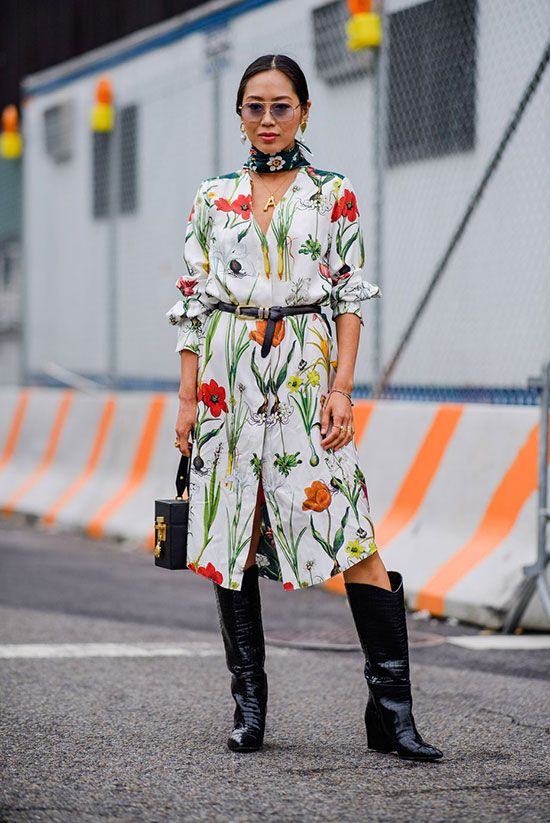 Chic Ways To Wear The Cowboy Boots Trend: Fashion blogger 'Song Of Style' wearing a floral neckerchief, a floral dress, a black belt, black western boots and a black box bag. fashion 2018, fall fashion trends, fall fashion, fall fashion trends 2018, street style, fall outfit, casual outfit, cowboy boots, cowboy boots trend, westernboots, nyfw 2018, party outfit, night out outfit #fashion2018, #casualstyle #fallstyle #fallfashion #cowgirl, #cowboyboots #westernboots #fashionweek #nyfw #nyfw2018 #