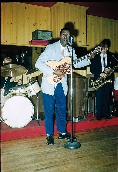 A very early and interesting picture of a Chuck Berry on stage. He is using a Harmony guitsr like Jimmy Reed and other Blues Artist used. This was before Mr. Berry switched to Gibson ES series guitars. I believe this guitar is the one used in his first recordings of 30 days and Maybelline....: