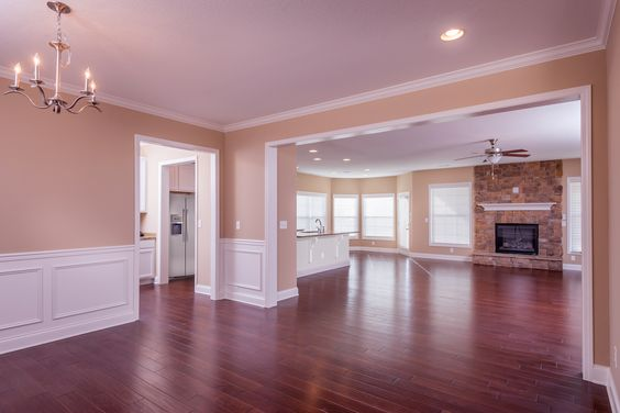 The formal dining room and living room of the Baldwin Expanded floor plan by Ball Homes