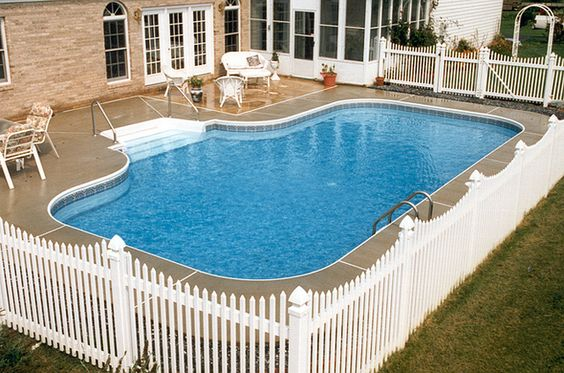 Create a clean pool look with a white fence