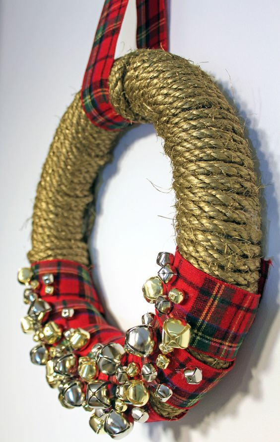 Project #3 from @Natalie Soud—A Dose of the Delightful: DIY Jingle Bell Wreath: Made with gold spray painted rope, assorted sleigh bells, plaid ribbon, wreath form.     #holiday #crafts #pinspirationparty