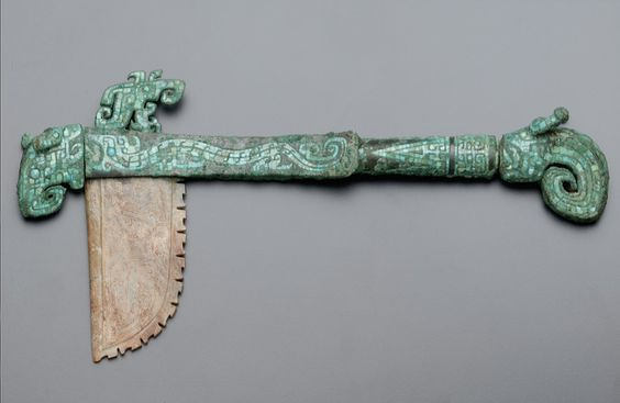 Hafted axe with dragons. ca. 1300-1200 B.C.E. Unidentified, Chinese   Late Shang dynasty  Early Anyang period Bronze with turquoise inlay and jade (nephrite) bladeAnyang,  China Smithsonian Museums