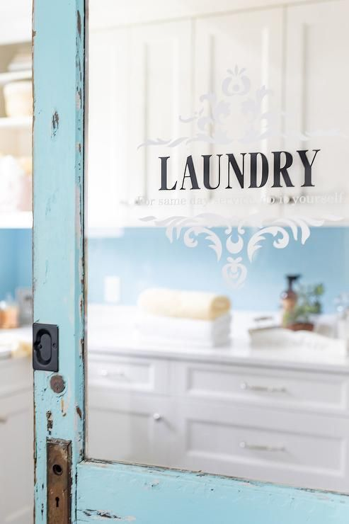 Charming Laundry Room With A Turquoise Blue Vintage Door Displaying Decorative Etching On The Glass Vintage Laundry Room Laundry Room Doors Vintage Door