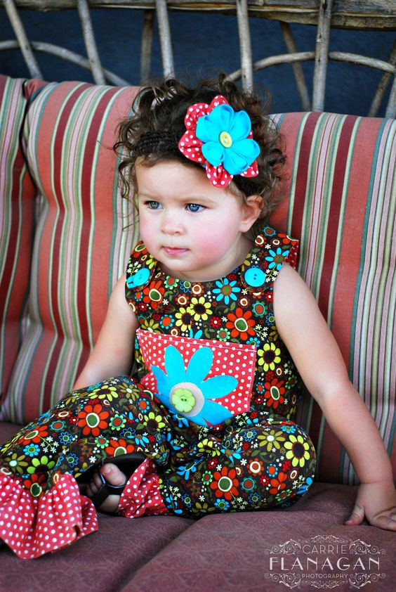 Back to School Fall Buttoned Romper in bright colored flowers and appliqued pocket from sizes 2 to 5 year. $37.00, via Etsy.