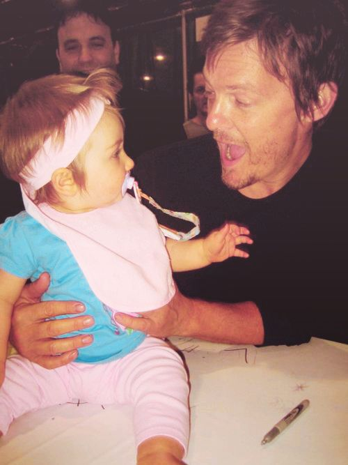 Norman Reedus holding a freaking baby. Brb......dying from ovary-explosion-inducing cuteness.