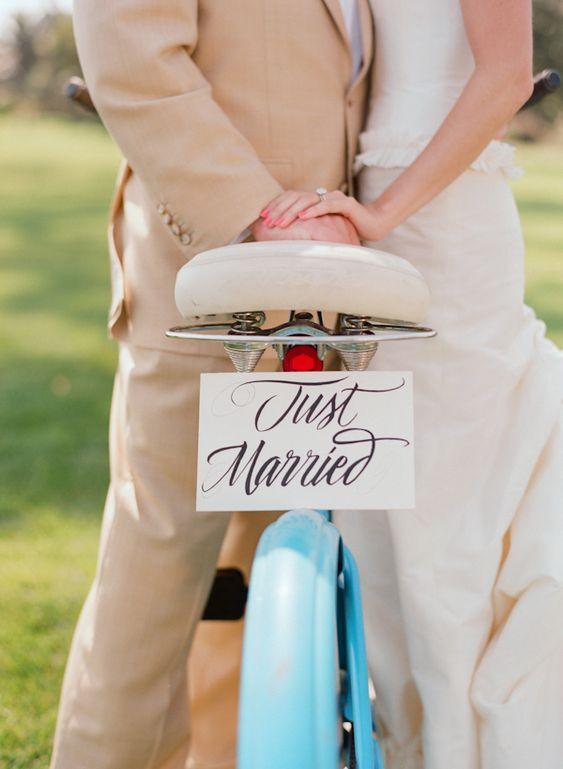 bride and groom with adorable bicycle wedding photo by Elizabeth Messina Photography via JunebugWeddings.com