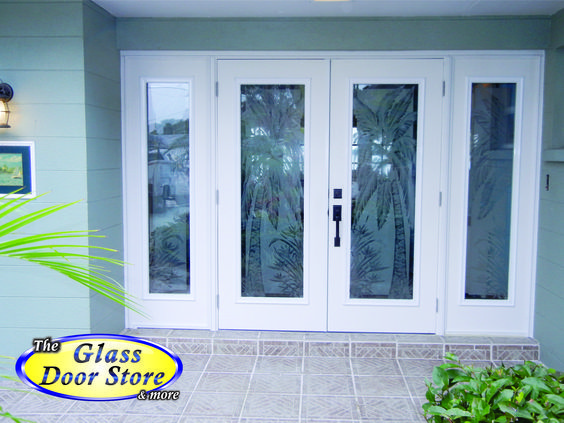Palm trees etched on hurricane impact glass front entryway. New fiberglass doors updated this home on the waterway. http://glassdoorstampa.com/etched-or-sandblasted-glass-doors/