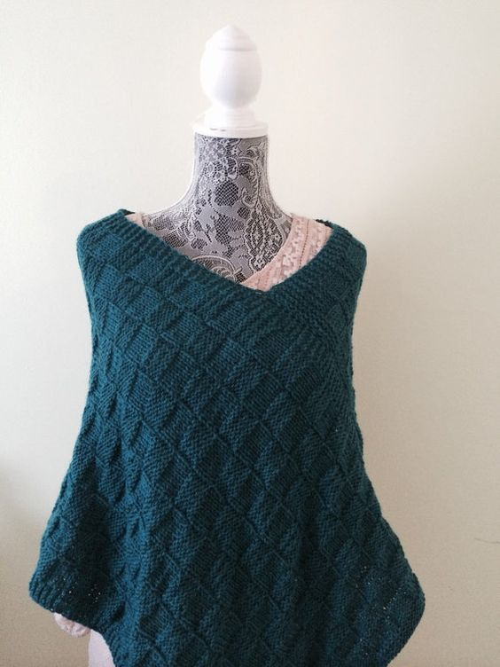 This azure heather poncho is a great fit for any season. It is knitted with soft 100% superwash wool. Its warm, soft and cozy good with look.