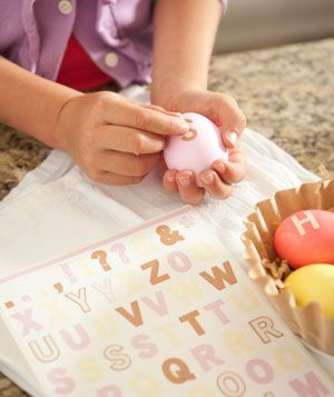Create monogrammed eggs with alphabet stickers