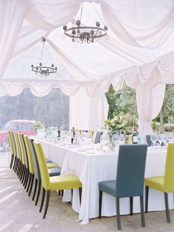 clear tent + white draping + chandeliers + green/grey chairs // wedding reception inspiration