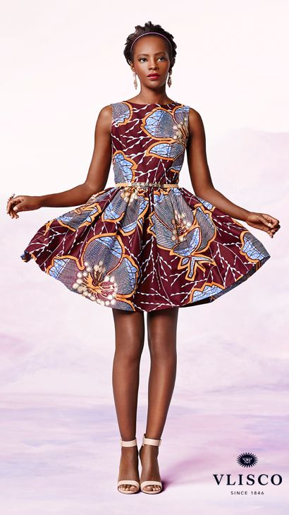 FLOWER FRESH | This playful mini dress is a lovely day-to-dark choice. Patterned with a garden-fresh flower motif in purple, bordeaux and golden embellishment, this piece features a flattering fit-and-flare silhouette. | Vlisco - The True Original | #vlisco #thetrueoriginal #dutchwax #waxhollandais #waxhollandis #ankara #ankarastyle #africanprint #africanprintfashion #africanfashion #dress #fashion: