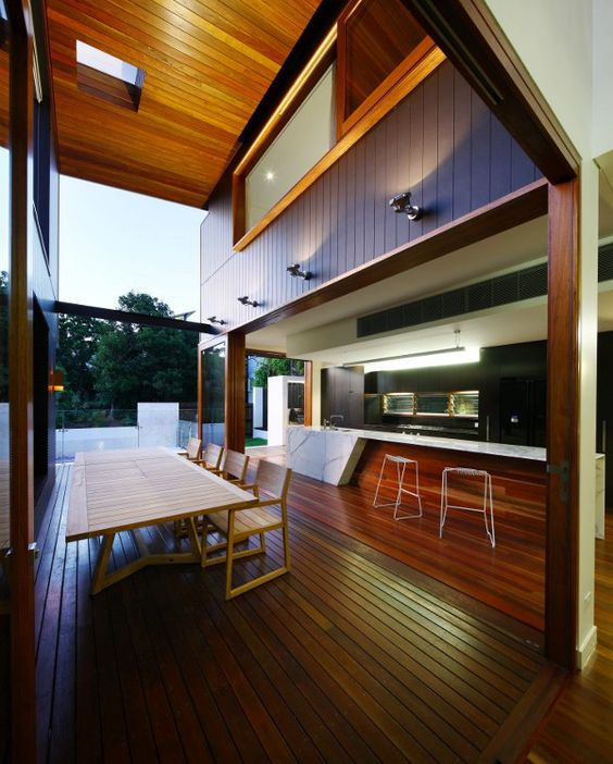 modern overhang. i like the wood on the ceiling, the double-height ceiling, open kitchen. Just add a giant garage door or lift-slide system and I'm set.