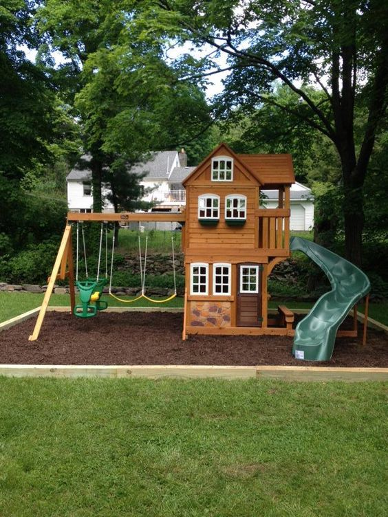 Mulch wood, wooden playset, swings, plastic slide and loads of fun for the kids.  See more excellent work at http://www.tristatedeliveryandassembly.com