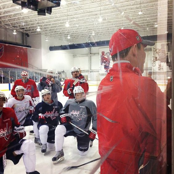 Players listen to Coach Oates during practice.