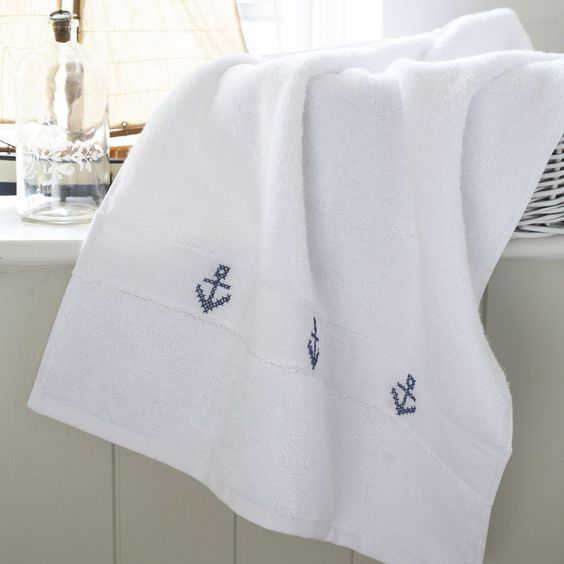 Add a nautical touch to plain towels with pretty cross-stitch patterns