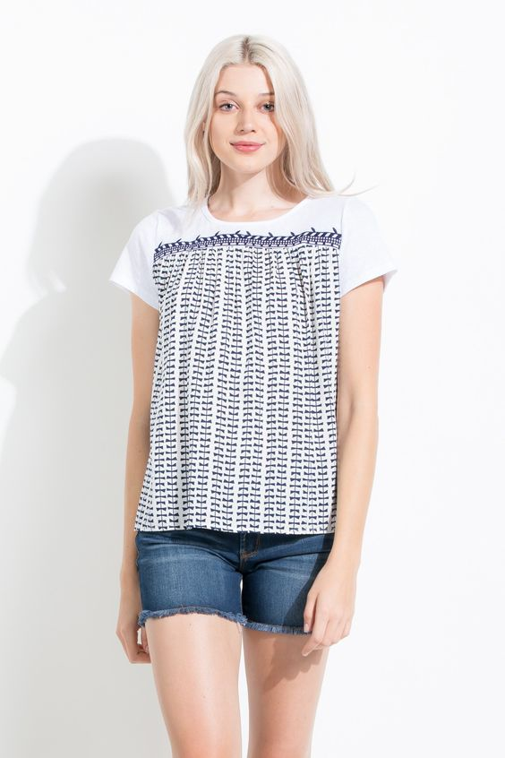 Loving the bow print and the trim detail! Perfect spring top to dress up jeans for the weekend or for school!