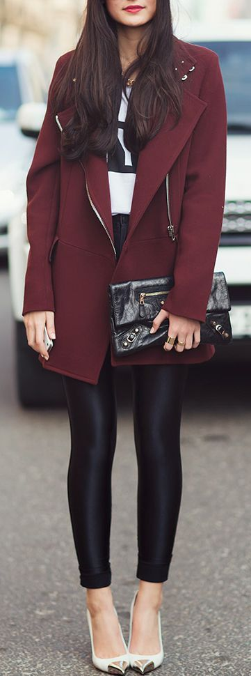Burgundy coat, black leather skinnies and Balenciaga clutch: