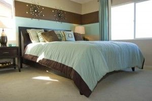 neutral and blue decorated bedroom