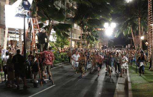 July 17, 2013:  Lewers street in ‪‎Waikiki‬ is shut down tonight to shoot scenes for the new ‪‎Godzilla‬ film, which is set to release next May. There were about 300 extras for a chase scene in the movie.  Photo by Jamm Aquino Source: Honolulu Star Advertiser