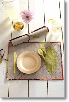 Roll up Picnic Placemat  Instead of a utensil holder, how about something to hold the napkin from blowing away?