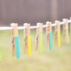 Brighten up your clothesline in less than 20 minutes with this DIY color dipped clothesline tutorial!