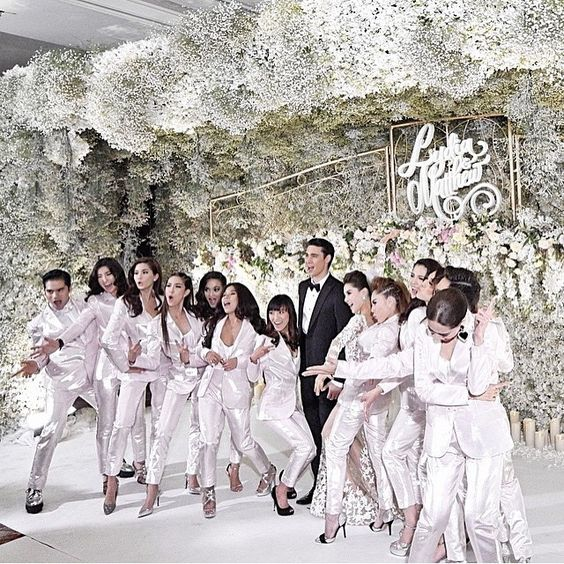Another picture from Lydia and Matthew wedding, the bridesmaids. This is certainly a fresh idea, dressing them in suits instead of dresses or kebaya; what an edgy choice! Loving this idea? Tag your friends who would love this!  Decor by and photo via @rainforestthewedding