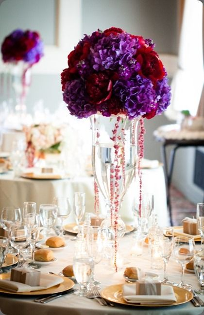 Tall purple and deep red centerpiece powers photography