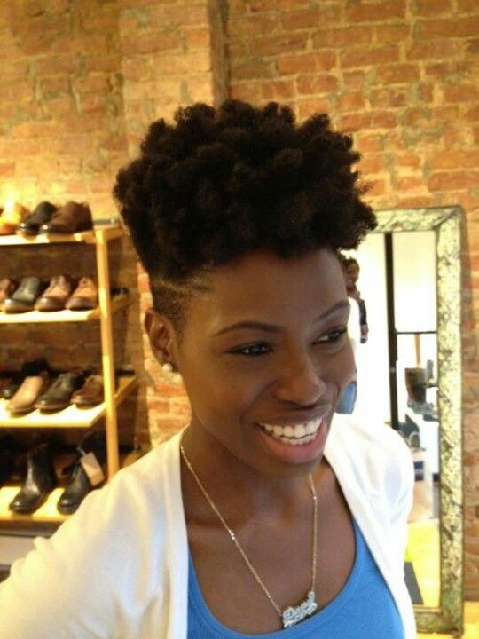Natural curly afro undercut