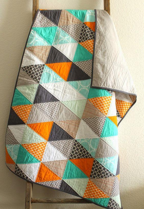 orange and aqua isosceles triangle quilt.