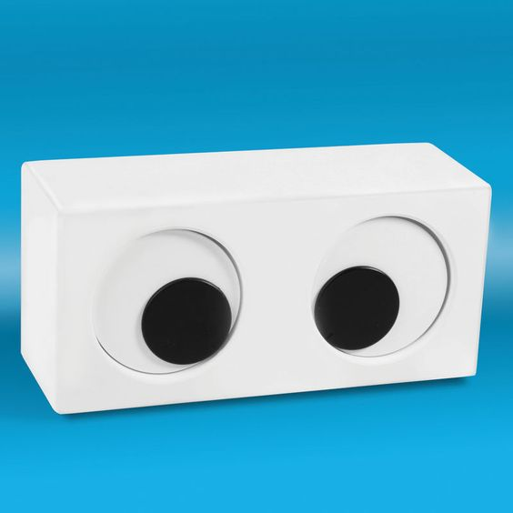 Googly Eyed Clock: The left eye fixes on the hour, the right on the minute. I think this might be an orthoptist's nightmare. On sale $29.99. <a href=