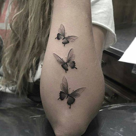 I normally don't like butterfly tattoos, but this is gorgeous!:
