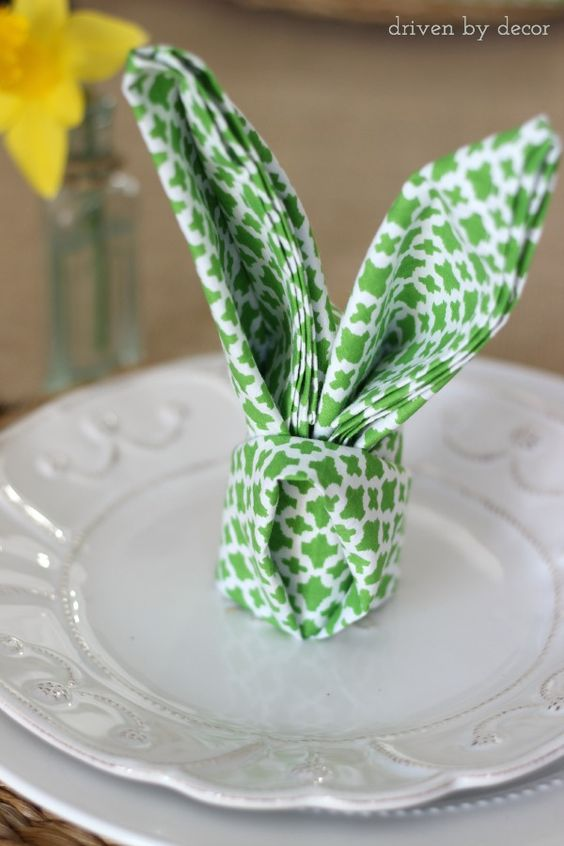 Napkin folded into rabbit ears - so cute for an Easter table setting!: