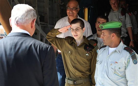 This photo, taken on October 11, 2001, shows Israeli solider Gilad Shalit saluting Israeli Prime Minister Benjamin Netanyahu after Shalit was released from five years of captivity in Gaza, where he had been held by Hamas.