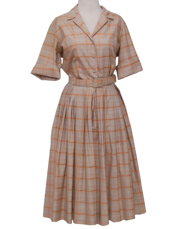 50s -No Label- Womens peachy orange and creamy taupe, blended cotton, shirtwaist dress, having short sleeves, with turned back cuffs. Vertical and French darts shape the bodice, with fabric covered buttons fastening the front, to the waist, below the narrow fold over collar.